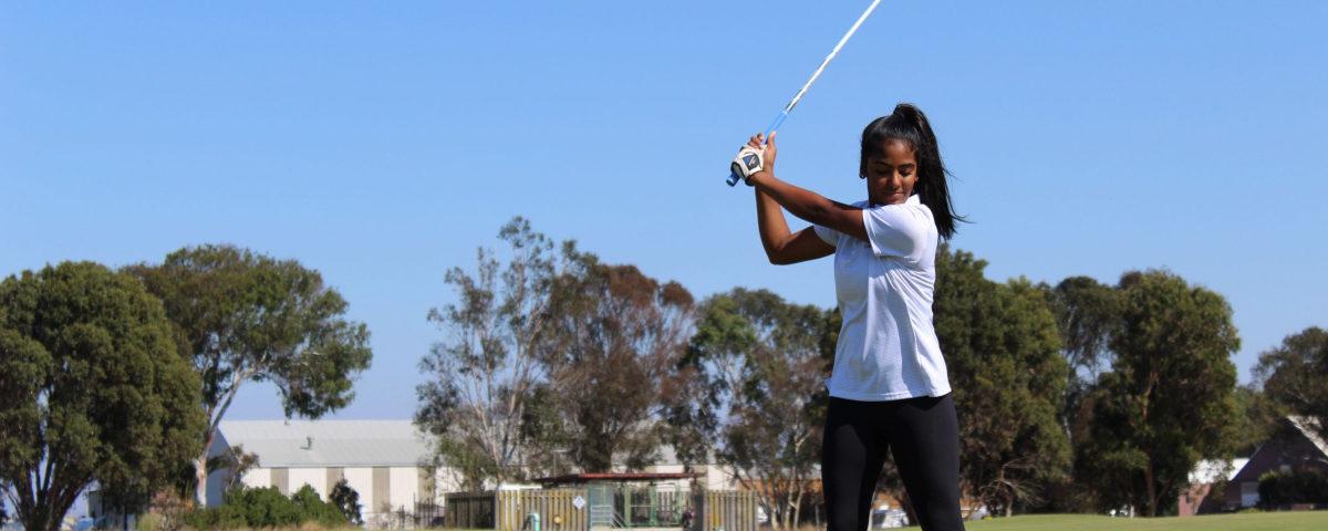 kvindelig golfspiller